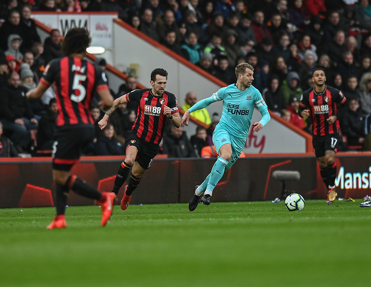 Newcastle United's Florian Lejeune (left) under pressure from Bournemouth's Charlie Daniels (right) <br /> <br /> Photographer David Horton/CameraSport<br /> <br /> The Premier League - Bournemouth v Newcastle United - Saturday 16th March 2019 - Vitality Stadium - Bournemouth<br /> <br /> World Copyright © 2019 CameraSport. All rights reserved. 43 Linden Ave. Countesthorpe. Leicester. England. LE8 5PG - Tel: +44 (0) 116 277 4147 - admin@camerasport.com - www.camerasport.com