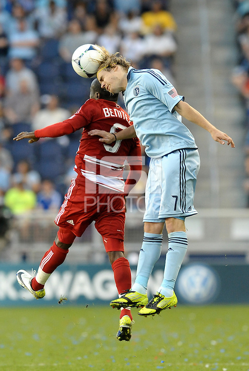 Chance Myers (7) Sporting KC defender beats FC Dallas midfielder Jair Benitez in the air... Sporting KC defeated FC Dallas 2-1 at LIVESTRONG Sporting Park, Kansas City, Kansas.