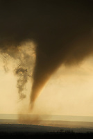 The classic funnel-shaped cloud of a tornado looms over the Palo Duro Canyon of west Texas in March of 2007