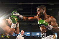 Tee Dwyer (white shorts) defeats Karim Khan at the Woodside Leisure Centre on 9th March 2019
