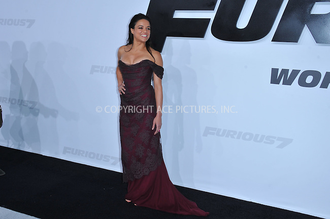 WWW.ACEPIXS.COM<br /> <br /> April 1 2015, LA<br /> <br /> Actress Michelle Rodriguez arriving at Universal Pictures Premiere of 'Furious 7'' at the TLC Chinese Theatre, Hollywood, on April 1, 2015 in Los Angeles.CA <br /> <br /> By Line: Peter West/ACE Pictures<br /> <br /> <br /> ACE Pictures, Inc.<br /> tel: 646 769 0430<br /> Email: info@acepixs.com<br /> www.acepixs.com