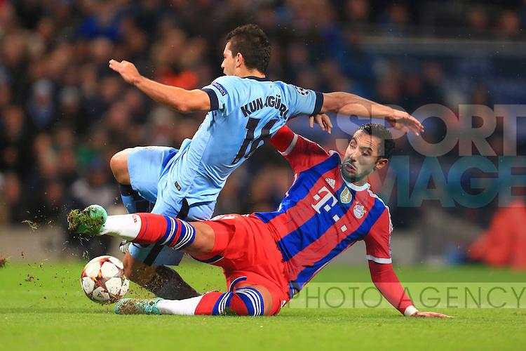 Mehdi Benatia of Munich brings down Sergio Aguero of Manchester City to earn a red card - Manchester City vs. Bayern Munich - UEFA Champion's League - Etihad Stadium - Manchester - 25/11/2014 Pic Philip Oldham/Sportimage