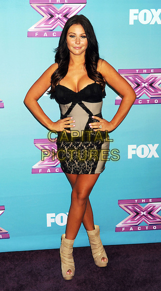 Jenni 'Jwoww' Farley.arriving at Fox's 'The X Factor' Season Finale Night 1 at CBS Televison City in Los Angeles, California, USA, .December 19th, 2012.  .full length beige black lace dress hands on hips ankle boots peep toe  cleavage .CAP/ROT/TM.©Tony Michaels/Roth Stock/Capital Pictures