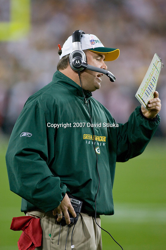 Head coach Mike McCarthy of the Green Bay Packers calls an offensive play during an NFL football game against the Chicago Bears at Lambeau Field on October 7, 2007 in Green Bay, Wisconsin. The Bears beat the Packers 27-20. (Photo by David Stluka)
