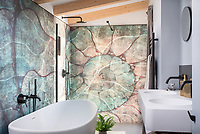 BNPS.co.uk (01202 558833)<br /> Pic: UniqueHomeStays/BNPS<br /> <br /> Pictured: There is a stunning bathroom with walk-in shower.<br /> <br /> A couple who spent £450,000 on turning a 'rotting shed' into an exclusive seaside bolthole hope to recoup their money - by renting it out for £3,150 a week. <br /> <br /> Tracey Gilpin and Peter Burridge went out on a limb when they bought the 60-year-old wooden shack for a whopping £220,000.<br /> <br /> Despite its ramshackle condition, the cabin could command such a hefty asking price as it is located halfway up a cliff with stunning views of Whitsand Bay in Cornwall.<br /> <br /> But in order to make the coastal chalet a viable holiday let the couple had to demolish it and build a new one from scratch.