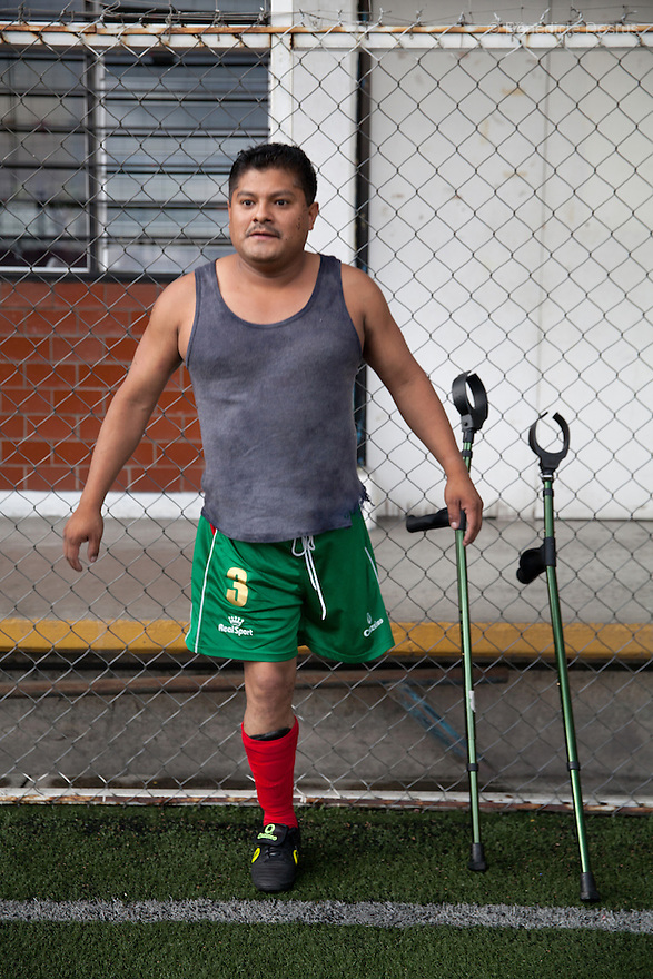 "Nesfero, a player from Guerreros Aztecas, portrayed during a training in Mexico City, Mexico on June 11, 2014. Nesfero Bazan Sierra, 37, lost his left leg 20 years ago after being hit by a stray bullet while at a party. He is married, father of four children and works with the NGO World Vision. Guerreros Aztecas (""Aztec Warriors"") is Mexico City's first amputee football team. Founded in July 2013 by five volunteers, they now have 23 players, seven of them have made the national team's shortlist to represent Mexico at this year's Amputee Soccer World Cup in Sinaloa this December. The team trains twice a week for weekend games with other teams. No prostheses are used, so field players missing a lower extremity can only play using crutches. Those missing an upper extremity play as goalkeepers. The teams play six per side with unlimited substitutions. Each half lasts 25 minutes. The causes of the amputations range from accidents to medical interventions – none of which have stopped the Guerreros Aztecas from continuing to play. The players' age, backgrounds and professions cover the full sweep of Mexican society, and they are united by the will to keep their heads held high in a country where discrimination against the disabled remains widespread. (Photo by Bénédicte Desrus)"