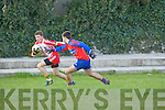 Sean Ó Bambaire (Pobalscoil Chorca,Dhuibhne) in action with Brendan Cronin (Killorgklin Internediate) at Auntin Stack Park, Connolly Park, Tralee on Wednesday.