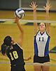 Long Beach No. 11 Tara Steiner, right, defends against a spike attempt by Wantagh No. 18 Jaimie Reich during the Nassau County varsity girls' volleyball Class A final at SUNY Old Westbury on Wednesday, Nov. 11, 2015. Wantagh won 3-0.<br /> <br /> James Escher