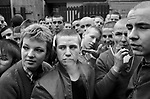 Skinheads wearing trade mark Bomber Jackets, at  National Front rally, march through Southwark South London 1980s. NF banners say Defend Our Old Folk Repatriate Muggers. 1980 UK.