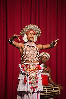 Kandy, man dancing traditional Kandyan dance, Kandy Arts Assication Hall, Sri Lanka, Asia. This is a photo of a man dancing traditional Kandyan dance at a tourist show at the Kandy Arts Assication Hall, Sri Lanka, Asia.