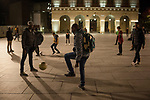 Some African migrants play football with local children in the main square. Irun (Basque Country). November 1, 2018. A group of volunteers has created a host network to serve migrants and inform about the public services they are entitled to and the ways to cross the border. This group of volunteers is avoiding a serious humanitarian problem Irun, the Basque municipality on the border with Hendaye. As the number of migrants arriving on the coasts of southern Spain incresead, more and more migrants are heading north to the border city of Irun. French authorities have reacted by conducting random checks as far as the city of Bordeaux, more than 200 kilometers north of the border. Migrants who are caught are then deported back to Irun. (Gari Garaialde / Bostok Photo).