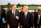 United States Secretary of Defense Donald H. Rumsfeld (left) escorts Minister of Foreign Affairs Shimon Peres of Israel into the Pentagon on August 1, 2002.  The two men will meet to discuss a range of issues of concern to both nations.  .Credit: R.D. Ward - DoD via CNP.