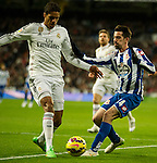 Real Madrid´s Raphael Varane and Deportivo de la Coruna's Isaac Cuenca during 2014-15 La Liga match between Real Madrid and Deportivo de la Coruna at Santiago Bernabeu stadium in Madrid, Spain. February 14, 2015. (ALTERPHOTOS/Luis Fernandez)