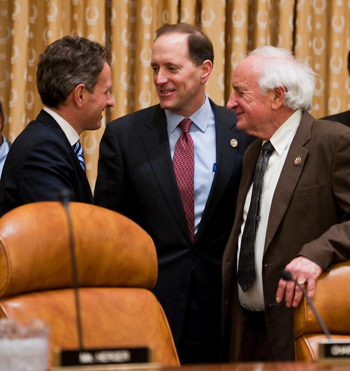 WASHINGTON, DC- Feb. 15: Chairman Dave Camp, R-Mich., middle, and ranking member Sander M. Levin, R-Mich., right, visit with Treasury Secretary Timothy F. Geithner  before the House Ways and Means hearing on President Obama's proposed fiscal 2012 budget. (Photo by Scott J. Ferrell/Congressional Quarterly)