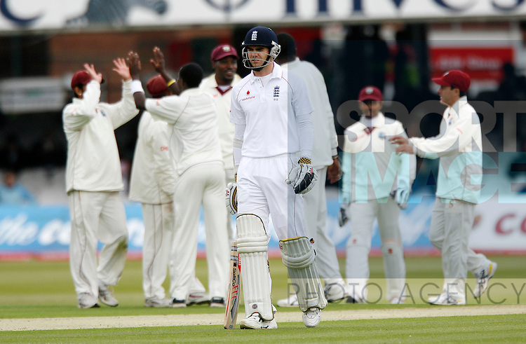 England's James Anderson gets out for 1 bowled by West Indies' Fidel Edwards