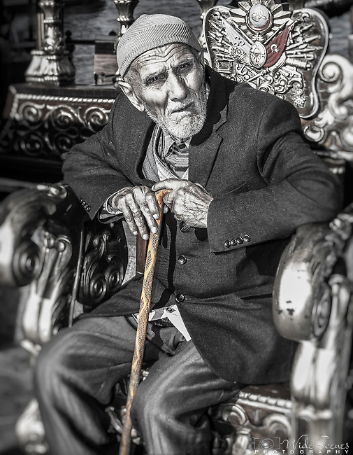Old man sitting at the port in Istanbul, Turkey.