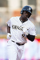 Jared Mitchell (9) of the Charlotte Knights rounds the bases after hitting a home run against the Chicago White Sox at BB&T Ballpark on April 3, 2015 in Charlotte, North Carolina.  The Knights defeated the White Sox 10-2.  (Brian Westerholt/Four Seam Images)