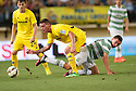 Celtic's Thomson challenges Cristian Galas.