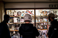 UK. Birmingham. 27th  October 2015<br /> Lions players look at the Birmingham University trophy cabinet while waiting for a training session.<br /> Andrew Testa for  the New York Times
