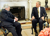 United States President George W. Bush meets with James Wolfensohn, the outgoing president of the World Bank, Thursday, April 14, 2005, in the Oval Office of the White House in Washington, DC.  Wolfensohn has been tapped to help coordinate Palestinian economic reforms and reconstruction efforts in Gaza.  <br /> Mandatory Credit: Paul Morse / White House via CNP
