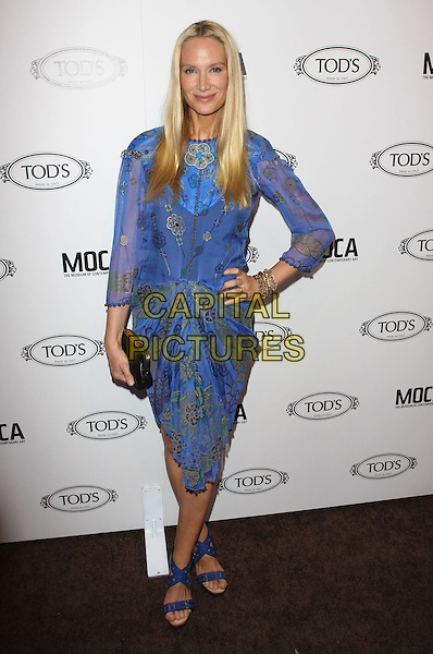 KELLY LYNCH.Tod's Beverly Hills boutique Grand Opening held At Tod's Boutique, Beverly Hills, California, USA. .April 15th, 2010 .full length blue purple dress print gold patterned open toe sandals bracelet black clutch bag sheer sleeves beaded hand on hip.CAP/ADM/KB.©Kevan Brooks/AdMedia/Capital Pictures.