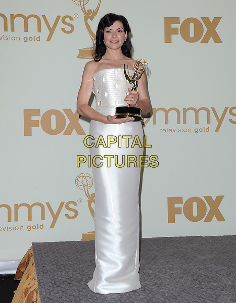 Julianna Margulies.The 63rd Anual Primetime Emmy Awards held at Nokia Theatre L.A. Live in Los Angeles, California, USA..September 18th, 2011.full length award trophy winner white strapless dress.CAP/RKE/DVS.©DVS/RockinExposures/Capital Pictures.