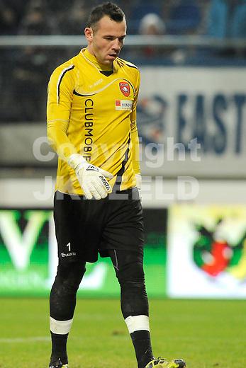HEERENVEEN - Voetbal, SC Heerenveen - FC Oss, knvb beker,  Abe Lenstra stadion, seizoen 2011-2012, 21-12-2011 FC Oss doelman Vincent Trier treurt na weer een treffer.