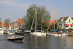 Boaters on the Spaarne River in Haarlem, Holland, the Netherlands.