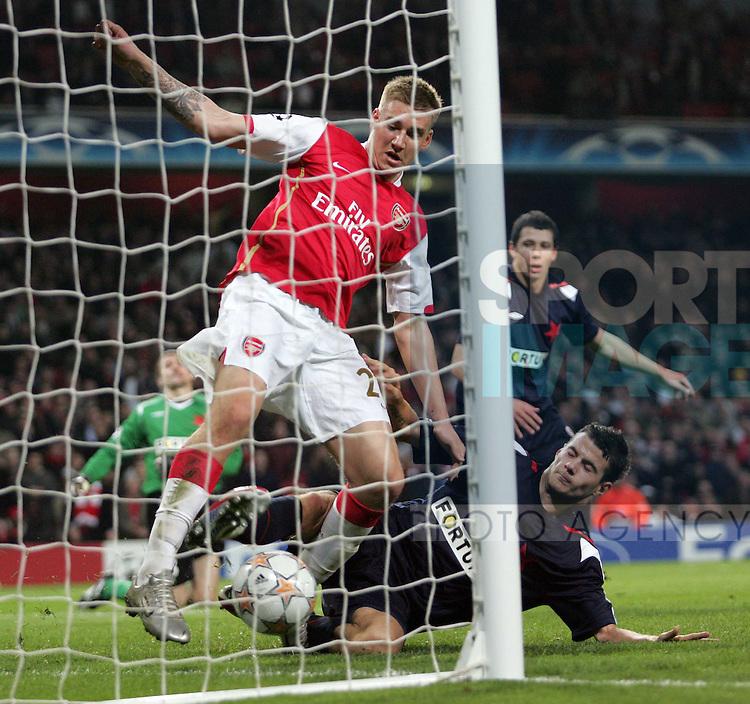 Arsenal's Nicolas Bendtner scoring his sides seventh goal