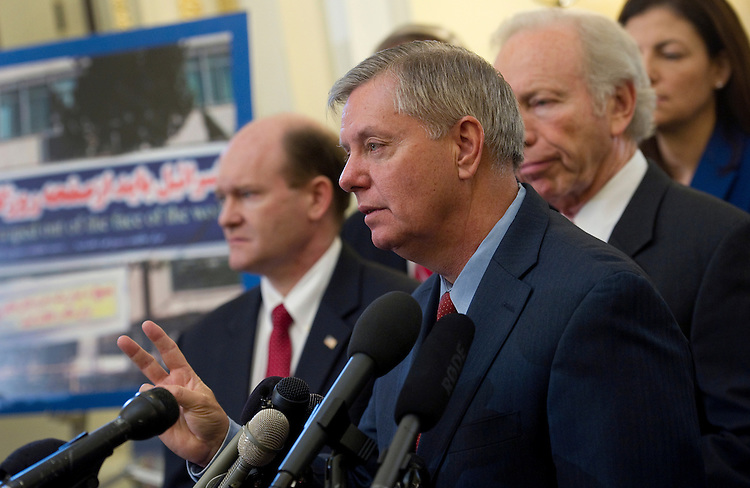 UNITED STATES - FEBRUARY 16: Sen. Chris Coons, D-Del.; Sen. Lindsey Graham, R-S.C.; Sen. Joe Lieberman, I-Conn.; and Sen. Kelly Ayotte, R-N.H., speak at a news conference on preventing Iran from acquiring a nuclear weapon and to introduce a bipartisan resolution that will put the Senate on record as ruling out a strategy of containment for a nuclear-armed Iran. (Photo By Chris Maddaloni/CQ Roll Call)