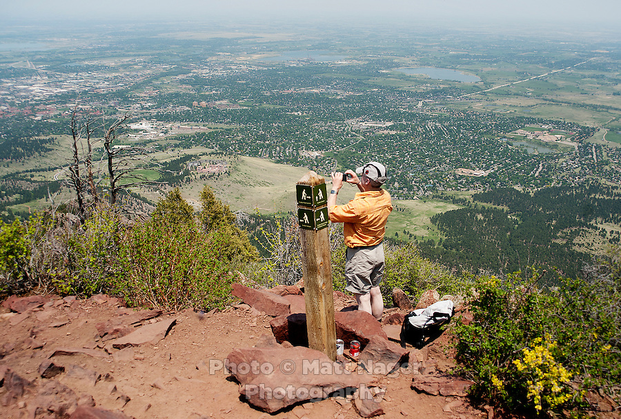 A man photographs on the summit of Bear Peak overlooking Boulder, Colorado, Saturday, June 4, 2011. Elevation is 8,416 feet. ..Photo by Matt Nager