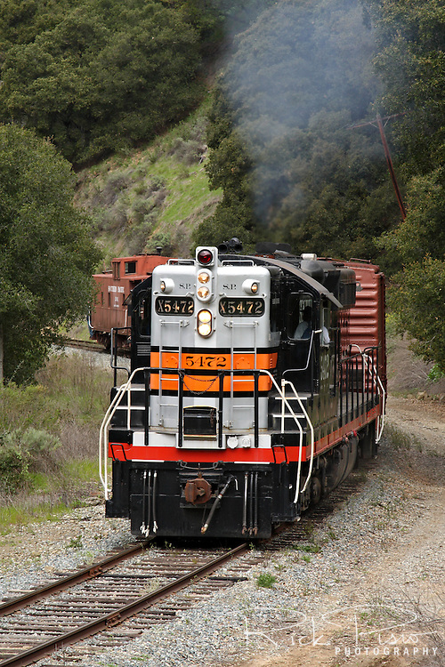 Southern Pacific SD-9 Diesel #5472 pulls a freight train through Sunol Canyon. Southern Pacific diesel number 5472 was built by GM EMD in La Grange, Il and delivered to SP in 1956.