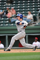 Left fielder Drew Weeks (10) of the Asheville Tourists bats in a game against the Greenville Drive on Friday, April 24, 2015, at Fluor Field at the West End in Greenville, South Carolina. Greenville won, 5-2. (Tom Priddy/Four Seam Images)