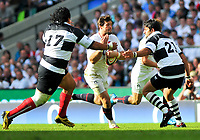 Ben Foden attracts the attention of two Barbarians defenders. MasterCard Trophy International match between England and the Barbarians on May 30, 2010 at Twickenham Stadium in London, England. [Mandatory Credit: Patrick Khachfe/Onside Images]