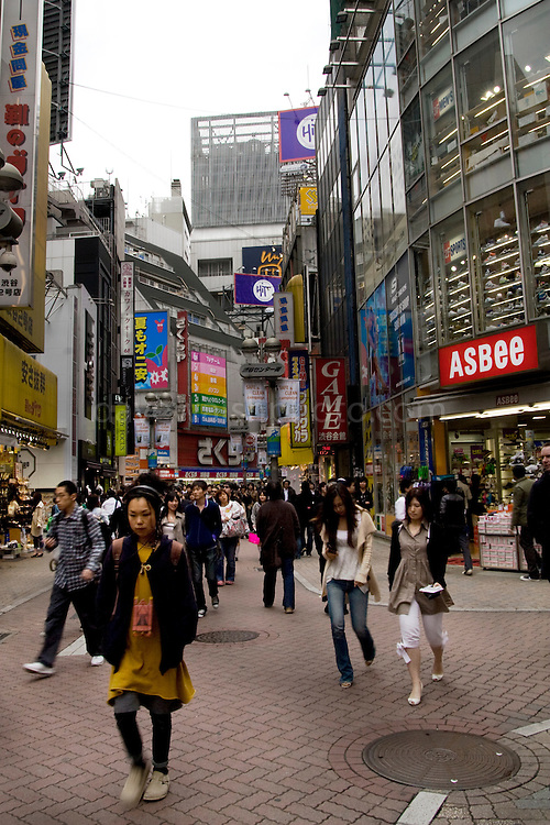 Shoppers in Shibuya, Tokyo, Japan, a busy shopping district..