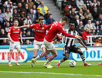 Christian Atsu of Newcastle United in action with Angus MacDonald of Barnsley in the box during the EFL Championship match at St James' Park Stadium, Newcastle upon Tyne. Picture date: May 7th, 2017. Pic credit should read: Jamie Tyerman/Sportimage
