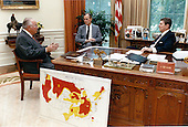 United States President Ronald Reagan, right, and U.S. Vice President George H.W. Bush, center, discuss the drought with U.S. Secretary of Agriculture Richard Lyng, left, in the Oval Office on Thursday, June 23, 1988..Mandatory Credit: Mary Anne Fackelman-Miner - White House via CNP