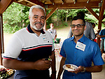 WATERTOWN,  CT-072118JS09--Edgar Castillo of the Dominican Republic and Dr. Ayaz Madraswalla of Storrs, at a reception for Health Horizons International held at Camp Mataucha in Watertown. Health Horizons International is an NGO dedicated to improving the delivery of primary care in the Dominican Republic. <br /> Jim Shannon Republican American