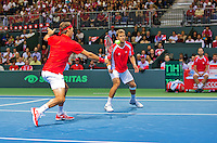 Switserland, Gen&egrave;ve, September 19, 2015, Tennis,   Davis Cup, Switserland-Netherlands, Doubles: Swiss team Marco Chiudinelli/Roger Federer (L)<br /> Photo: Tennisimages/Henk Koster