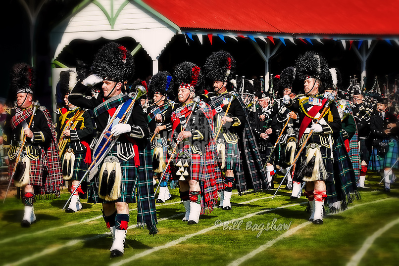 The massed pipe bands salute the Royal Stand at The Braemar Gathering. Her Majesty The Queen is Chieftain of The Braemar Gathering