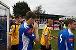 Wealdstone 0 Newport County 0, 17/03/2012. St Georges Stadium, FA Trophy Semi Final. Rival team's players walking on to the pitch at St Georges Stadium, home ground of Wealdstone FC, before the club played host to Newport County (in yellow) in the semi-final second leg of the F.A. Trophy. The game ended in a goalless draw, watched by a capacity crowd of 2,092 which meant the visitors from Wales progressed by three goals to one to the competition's final at Wembley, where they would meet York City. The F.A. Trophy was the premier cup competition for non-League clubs in England and Wales affiliated to the Football Association. Photo by Colin McPherson.
