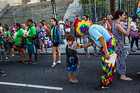 "RIO DE JANEIRO, BRAZIL - FEBRUARY 23, 2014: João Batista dos Santos, 56, an outpatient of the Instituto Philippe Pinel psychiatric hospital entertains a boy with a magic trick during the annual Tá Pirando, Pirado, Pirou! carnival street parade on February 23, 2014 in Rio De Janeiro, Brazil. João Batista dos Santos, 56, who was hospitalized several times before being diagnosed with bipolar disorder and treated with lithium: ""In the asylum João Batista came to see / That being crazy is easy. What's hard is being me."" It looks like any of the other 450 or so street parties, locally called ""carnival blocks,"" that parade through Rio de Janeiro during the raucous pre-Lenten festivities that draw hundreds of thousands to the city each year. What makes this party different are its performers and organizers: psychiatric patients and their doctors, therapists, family members, neighbors and passers-by. The group, called Tá Pirando, Pirado, Pirou!, which roughly translates as ""We're freaking out, we already freaked out!"", began ten years ago when Brazil was in the process of dismantling its century-old system of mental asylums. A law passed in 2001 called for long-term outpatient psychiatric care to be offered primarily in community clinics. The number of such clinics increased more than fivefold in the following decade, while the number of asylum beds for psychiatric patients dropped 40 percent nationwide.<br /> <br /> Daniel Berehulak for The New York Times"