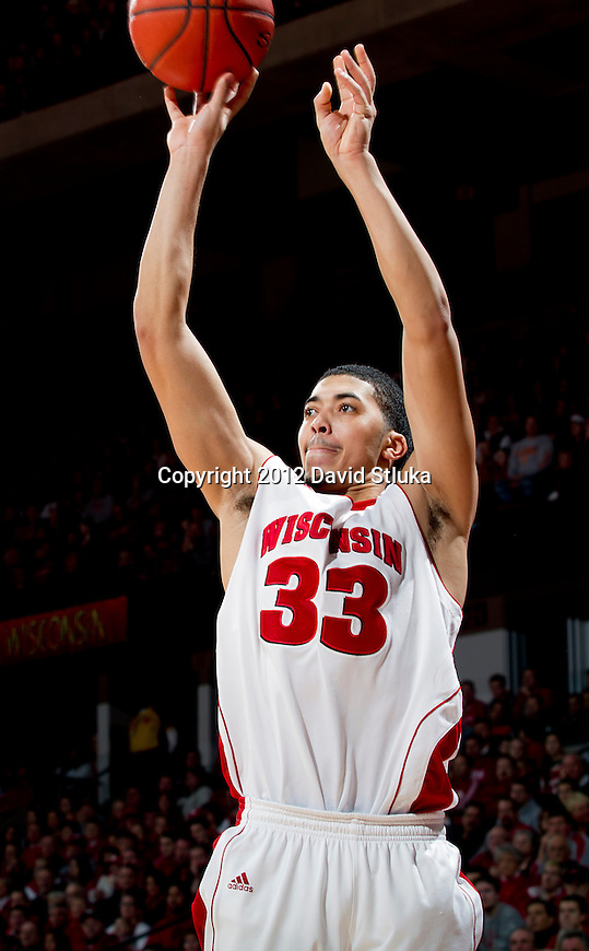 Wisconsin Badgers forward Rob Wilson (33) shoots the ball during a Big Ten Conference NCAA college basketball game against the Illinois Fighting Illini on Sunday, March 4, 2012 in Madison, Wisconsin. The Badgers won 70-56. (Photo by David Stluka)