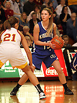 SIOUX FALLS, SD - FEBRUARY 28:  Claire Howes #15 from O'Gorman looks for a teammate past the defense of Lauren Kunz #21 from Roosevelt in the second half of their District 1AA Championship Game Thursday night at Roosevelt. (Photo by Dave Eggen/Inertia)