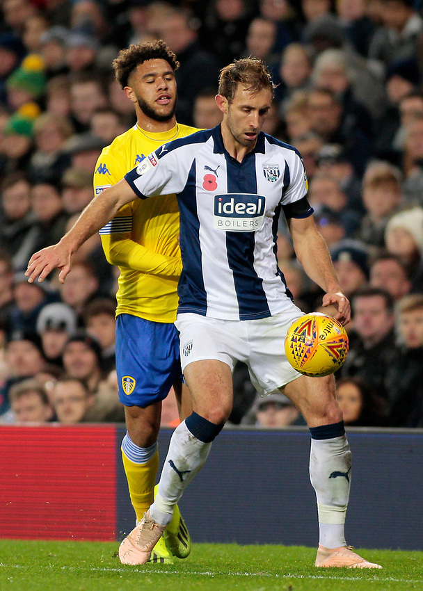 West Bromwich Albion's Craig Dawson shields possession from Leeds United's Tyler Roberts<br /> <br /> Photographer David Shipman/CameraSport<br /> <br /> The EFL Sky Bet Championship - West Bromwich Albion v Leeds United - Saturday 10th November 2018 - The Hawthorns - West Bromwich<br /> <br /> World Copyright © 2018 CameraSport. All rights reserved. 43 Linden Ave. Countesthorpe. Leicester. England. LE8 5PG - Tel: +44 (0) 116 277 4147 - admin@camerasport.com - www.camerasport.com