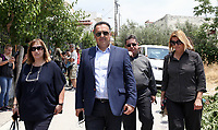 Pictured: Local mayor Yiannis Kassavos (C) arrives at the 6th primary School in Acharnes, Athens, Greece. Saturday 10 June 2017<br /> Re: An 11 year old boy has been shot dead by a &quot;stray bullet&quot; during a school celebration in Acharnes (Menidi) area, in the outskirts of Athens, Greece.<br /> Marios Dimitrios Souloukos &quot;complained to his mum&quot; who works as a teacher at the 6th Primary School of Acharnes that he was feeling unwell, he then collapsed with blood pouring out from the top of his head.<br /> His mum tried to revive him assisted by other teachers while his schoolmates who were reportedly upset, were hurriedly removed by their parents.<br /> According to locals an ambulance arrived 25 minutes late.<br /> Hundreds of police officers have been deployed in the area and have raided many properties.<br /> Shells matching the fatal bullet which hit the boy on the top of his head were found in a house yard nearby.<br /> Local people reported hearing shots being fired at a nearby Romany Gypsy camp before the fatal incident.<br /> The area has been plagued with criminality during the last few years.