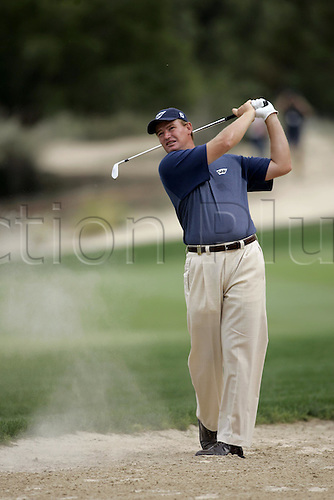 5 March 2005: South African golfer Ernie Els (RSA) looks into the distance after playing an iron from the desert just off the fairway during round three of the Dubai Desert Classic held on the Majlis Course at the Emirates Golf Club, Dubai, United Arab Emirates. Photo: Neil Tingle/Action Plus..050305 male man men golf golfer golfers