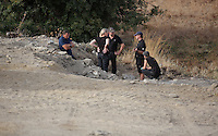 Pictured: Forensic archaeologists at the second site in Kos, Greece. Wednesday 12 October 2016<br />