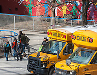 School buses line up in front of PS 33 in Chelsea in New York on Monday, March 13, 2017. Because of the approaching snowstorm Mayor Bill De Blasio has ordered schools to be closed on Tuesday as well as alternate side of the street parking being suspended. (© Richard B. Levine)