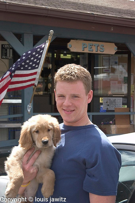boy with dog and american flag whist on up portrait
